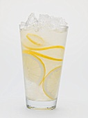A glass of lemonade with crushed ice