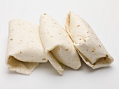 Three tortilla parcels