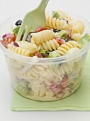 Pasta and vegetable salad in plastic container