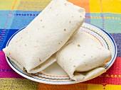Two tortilla parcels on plate