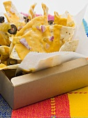 Tortilla chips with cheese, olives and onions to take away