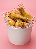 Breaded chicken pieces to take away (red background)