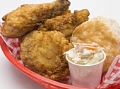 Fried chicken with coleslaw and scone in plastic basket