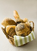 Assorted breads and bread rolls in bread basket