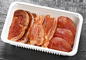 Seasoned poultry meat in plastic container