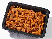 Strips of pork (gyros style) in plastic container