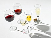 Various wines in glasses, one glass of sparkling wine