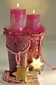 Christmas decoration: two pink candles in glasses