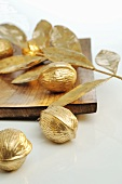 Christmas decorations: gold nuts and leaves