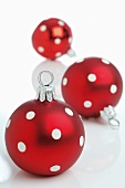 Red Christmas baubles with white spots