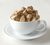 Brown sugar cubes in cup