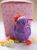 Purple Easter chick and sugar eggs