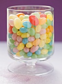 Coloured jelly beans in glass