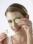 Woman with cucumber face mask