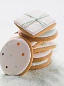 Assorted iced biscuits on blue sugar