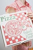 Woman holding pizza box