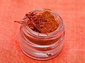 Saffron powder and saffron threads in screw-top jar