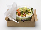 Avocado salad with sprouts in plastic container to take away