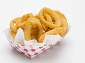 Deep-fried onion rings in paper dish