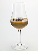 Cream liqueur with ice cubes in a glass