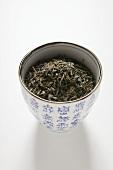 Tea leaves in Asian bowl