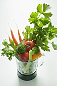 Fresh vegetables and parsley in a liquidiser