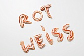 The words ROT WEISS (red & white) in ketchup & mayonnaise