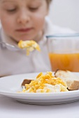 Little boy eating scrambled egg