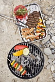 Vegetables on barbecue, meat, sausages, kebabs in dish