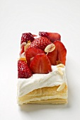 Puff pastry slice with strawberries, cream & flaked almonds