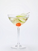 Drink with cocktail cherry and lime