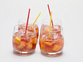 Fruity red wine punch in four glasses