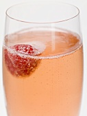 Sparkling wine cocktail with raspberry