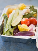 Vegetables in aluminium dish, ready for grilling