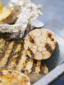 Grilled fish fillet with garlic and baked potato