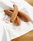 Three cheese-stuffed sausages on paper