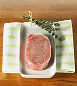 Raw loin of pork and bunch of thyme