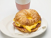 Croissant filled with scrambled egg, cheese and bacon