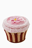 Cupcake with pink icing and sugar flower
