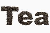 Schrift Tea aus getrockneten Teelbättern