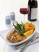 Fillet of pork with orange sauce, beans & sweet potato mash