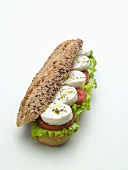 Soft cheese and tomato in wholegrain roll