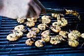 Prawn skewers on a barbecue