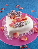 Heart-shaped cake with flower petals for Valentine's Day