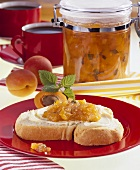 Apricot & nectarine jam in preserving jar & on slice of bread
