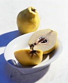 Whole and halved quince