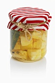 Pickled sheep's cheese in a jar