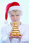 Girl holding biscuit Christmas tree