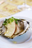 Oyster with slices of apple