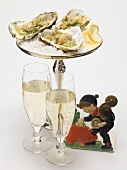 Oysters au gratin, glasses of sparkling wine & lucky charm